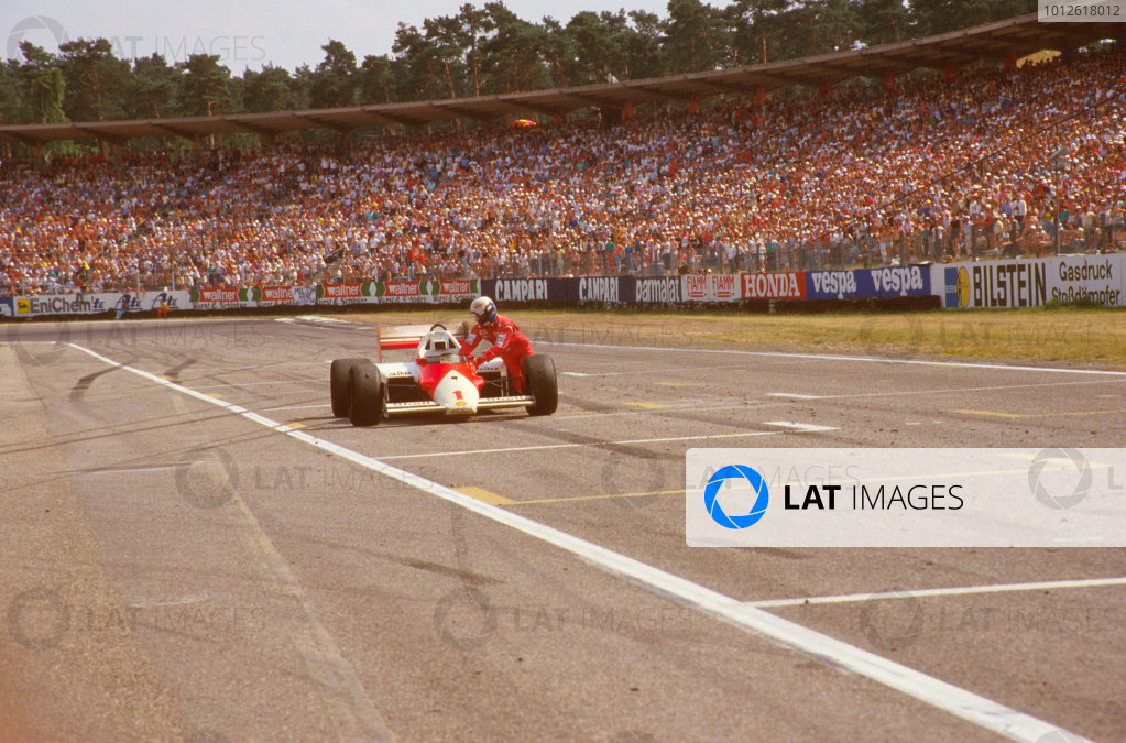 Hockenheim, Germany.25-27 July 1986.Alain Prost (McLaren MP4/2C TAG Porsche) ran out of fuel on the last lap and dropped from 3rd to 6th position, as he pushes his car across the finish line.Ref-86 GER 02.World Copyright - LAT Photographic