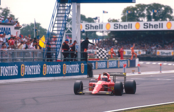 1990 British Grand Prix. Silverstone, England. 13-15 July 1990. Alain Prost (Ferrari 641) takes the chequered flag for 1st position. Ref-90 GB 13. World Copyright - LAT Photographic