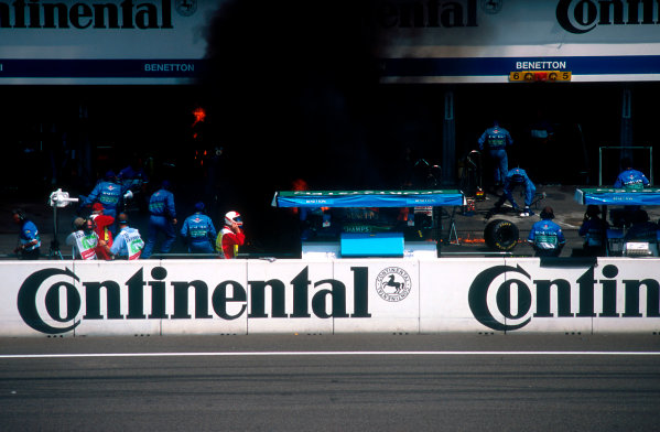 1994 German Grand Prix.Hockenheim, Germany.29-31 July 1994.Jos Verstappen (Benetton B194 Ford) came in for his pitstop. As the Refueller pulled the fuel hose away the valve stuck open allowing fuel to still come out of the nozzle and over the car which ignited into a huge fireball. The fire was delt with quite swiftly though.Ref-94 GER 45.World Copyright - LAT Photographic