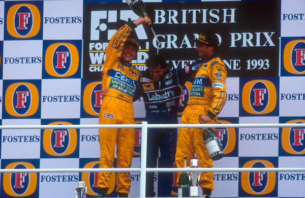 1993 British Grand Prix.Silverstone, England.9-11 July 1993.Alain Prost (Williams Renault) 1st position with Michael Schumacher 2nd position and Riccardo Patrese, 3rd position (both Benetton B193B Ford's) on the podium.Ref-93 GB 07.World Copyright - LAT Photographic