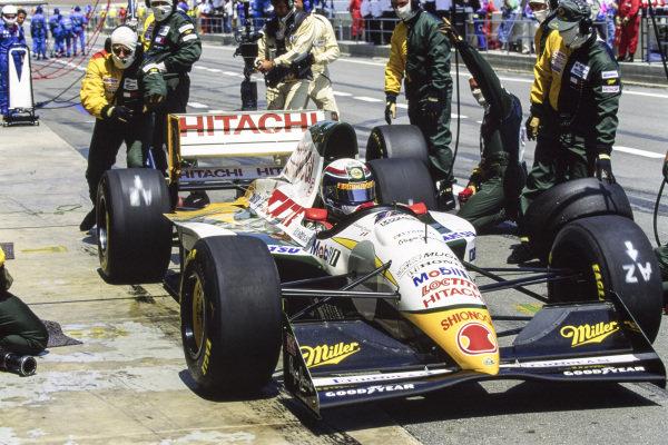 Alessandro Zanardi, Lotus 107C Mugen-Honda, makes a pitstop.