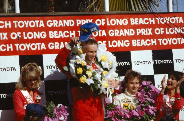 1982 United States Grand Prix West.Long Beach, California, USA.2-4 April 1982.Niki Lauda (McLaren Ford) 1st position and Gilles Villeneuve (Ferrari) 3rd position on the podium.Ref-82 LB 09.World Copyright - LAT Photographic
