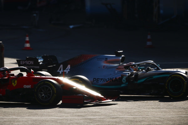 Lewis Hamilton, Mercedes AMG F1 W10, passes Charles Leclerc, Ferrari SF90