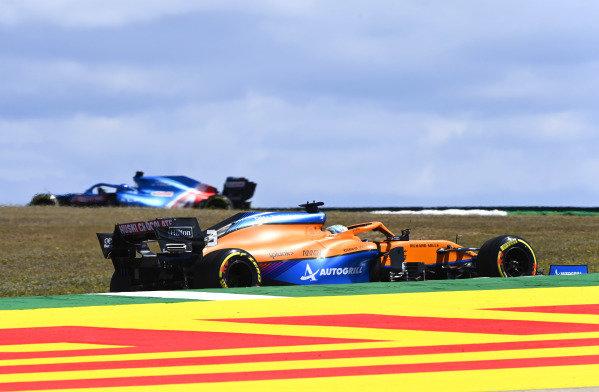 Fernando Alonso, Alpine A521, leads Daniel Ricciardo, McLaren MCL35M
