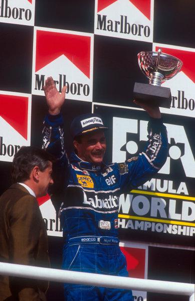 1992 Hungarian Grand Prix.Hungaroring, Budapest, Hungary.14-16 August 1992.Nigel Mansell (Williams Renault) celebrates 2nd position on the podium and winning the drivers World Championship.Ref-92 HUN 02.World Copyright - LAT Photographic