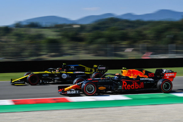 Esteban Ocon, Renault R.S.20, leads Alexander Albon, Red Bull Racing RB16