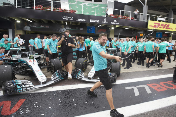 Lewis Hamilton, Mercedes AMG F1, Valtteri Bottas, Mercedes AMG F1, and the Mercedes team celebrate with Champagne after securing the drivers and constructors titles for 2018