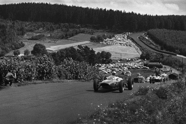 Nurburgring, Germany. 4 August 1963.  John Surtees (Ferrari 156), 1st position, leads Jim Clark (Lotus 25-Climax), 2nd position, at Flugplatz.  World Copyright: LAT Photographic.Ref:  L63 - 242 -12A.