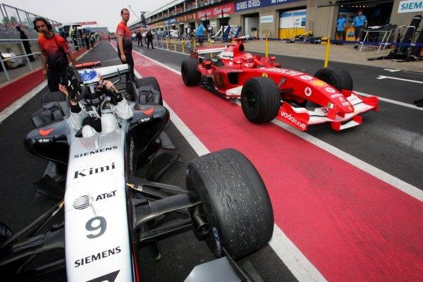 Race winner Kimi Raikkonen (FIN) McLaren and Michael Schumacher (GER) Ferrari F2005 in parc ferme. Formula One World Championship, Rd 8, Canadian Grand Prix, Race, Montreal, Canada, 12 June 2005.DIGITAL IMAGE