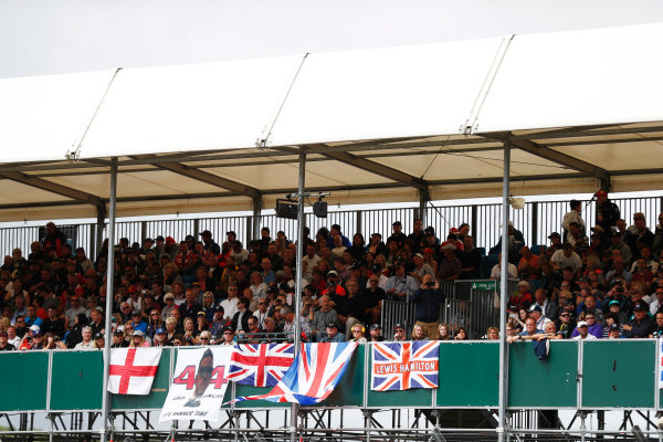 Silverstone, Northamptonshire, UK.  Sunday 16 July 2017. Flags and banners in support of Lewis Hamilton, Mercedes AMG, are displayed on a packed stand. World Copyright: Glenn Dunbar/LAT Images  ref: Digital Image _31I6313