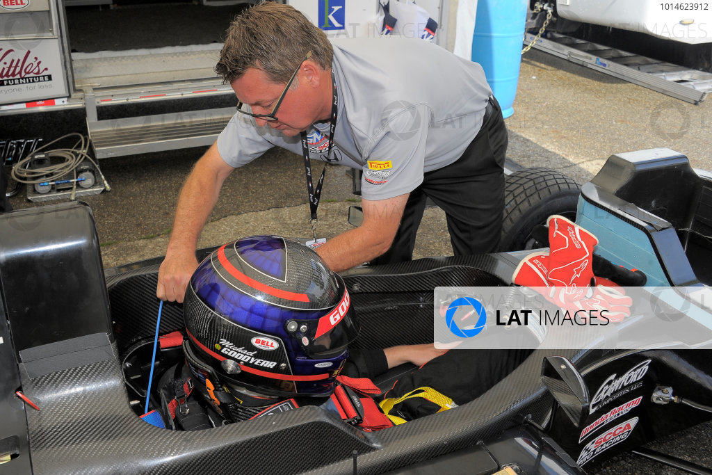 30 June-3 July, 2016, Lexington, Ohio USA Former IndyCar driver, Scott Goodyear helping his son, Michael, buckle into car ©2016, Dan R, Boyd LAT Photo USA