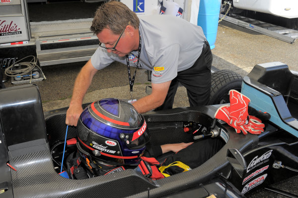 30 June-3 July, 2016, Lexington, Ohio USA Former IndyCar driver, Scott Goodyear helping his son, Michael, buckle into car ©2016, Dan R, Boyd LAT Photo USA