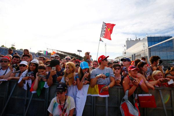 Hungaroring, Budapest, Hungary. Thursday 21 July 2016. Fans wait in the pit lane. World Copyright: Andrew Hone/LAT Photographic ref: Digital Image _ONZ0723