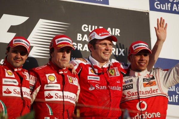 (L to R): Felipe Massa (BRA) Ferrari, Fernando Alonso (ESP) Ferrari, Stefano Domenicali (ITA) Ferrari General Director and Lewis Hamilton (GBR) McLaren on the podium.  Formula One World Championship, Rd 1, Bahrain Grand Prix, Race, Bahrain International Circuit, Sakhir, Bahrain, Sunday 14 March 2010.