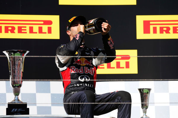 Hungaroring, Budapest, Hungary. Sunday 26 July 2015. Daniel Ricciardo, Red Bull Racing, 3rd Position, downs some Champagne on the podium. World Copyright: Glenn Dunbar/LAT Photographic ref: Digital Image _W2Q1187