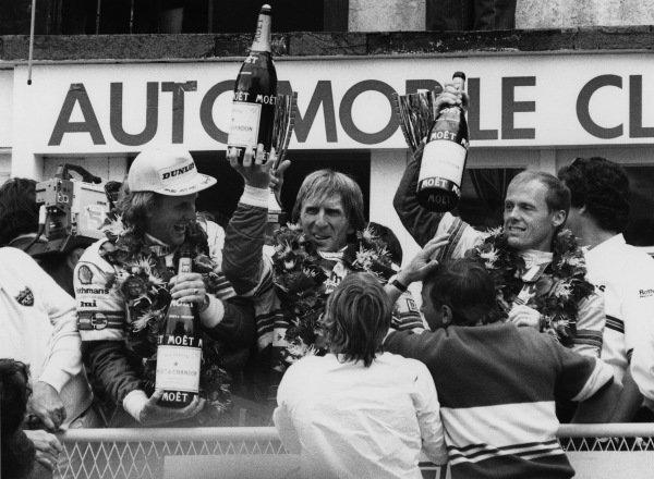 Le Mans, France. 31st May - 1st June 1986.Hans-Joachim Stuck /Derek Bell /Al Holbert (Porsche 962C), 1st position, podium, portrait. World Copyright: LAT PhotographicRef: B/W Print.