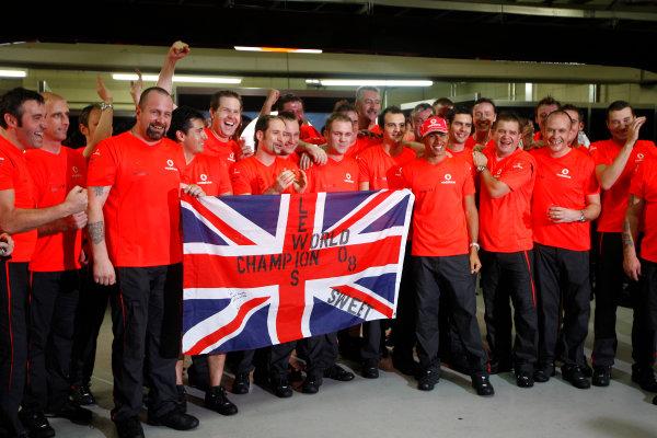Interlagos, Sao Paulo, Brazil2nd November 2008Lewis Hamilton, McLaren MP4-23 Mercedes, 5th position, celebrates his drivers title with the McLaren team. Portrait. World Copyright: Andrew Ferraro / LAT Photographic ref: Digital Image _O9T5743