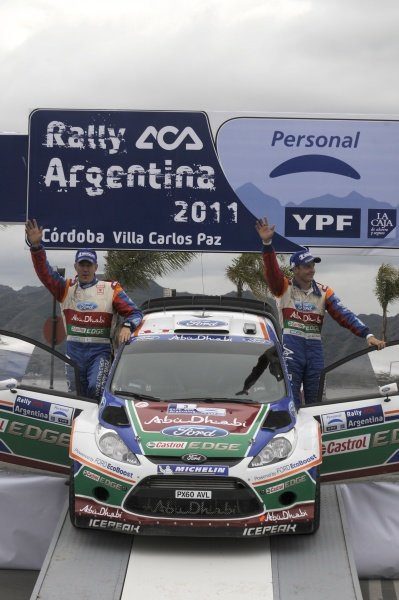 Second placed Mikko Hirvonen (FIN) and co-driver Jarmo Lehtinen (FIN), Ford Fiesta RS WRC, on the podium.World Rally Championship, Rd6, Rally Argentina, Villa Carlos Paz, Cordoba, Argentina, Day Three, Sunday 29 May 2011.