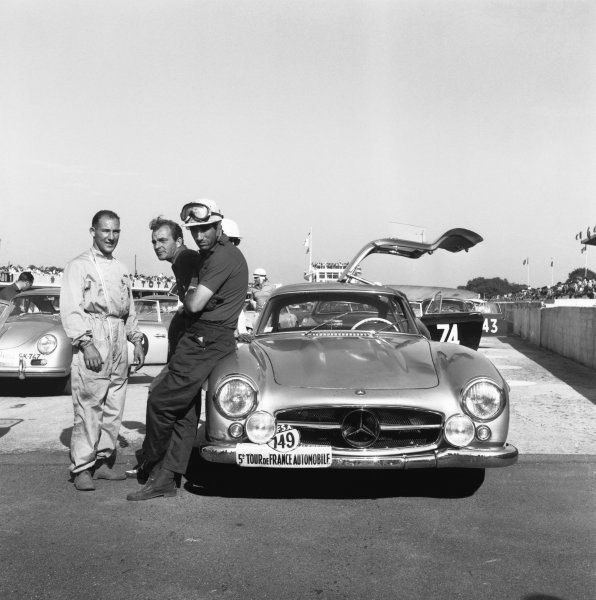 France. 17th - 23rd September 1956.Stirling Moss (Mercedes-Benz 300SL), 2nd position, talks with co-driver Georges Huel and Harry Schell, portrait.World Copyright: LAT Photographic.Ref: 861.