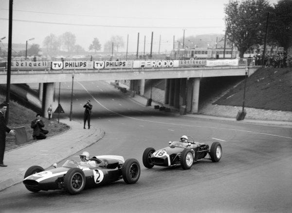 Heysel, Brussels, Belgium. 9th April 1961.Stirling Moss (Lotus 18-Climax), retired, chase Jack Brabham (Cooper-Climax), 3rd position, action.World Copyright: LAT PhotographicRef:  Autocar Glass Plate C61327.