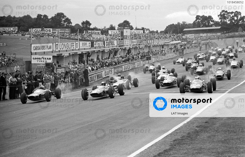 Start. John Surtees, Lola T60 Ford, battles with Jim Clark, Lotus 35 Ford, and Denny Hulme, Brabham BT16 Ford, off the line.