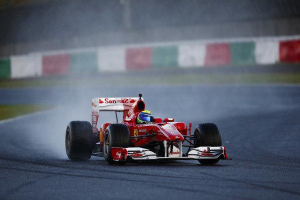 Felipe Massa demonstrates a historic Ferrari F1 car.