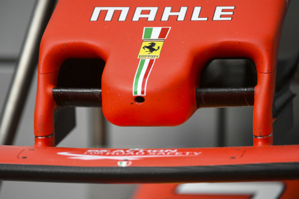 The Ferrari logo on the nose of a car