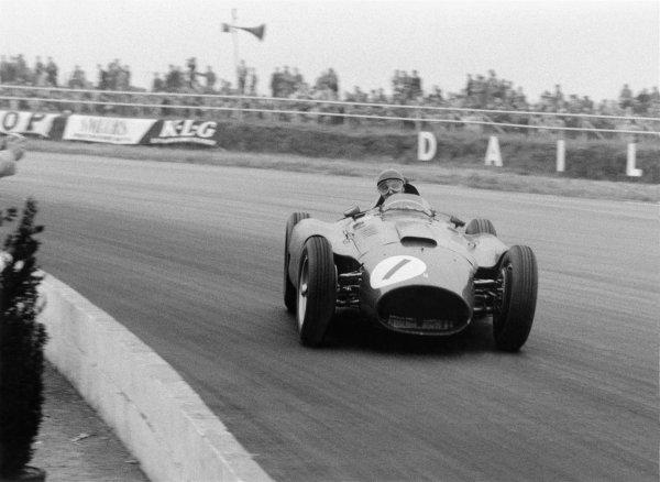 1956 British Grand Prix. Silverstone, Great Britain. 14 July 1956. Juan Manuel Fangio (Lancia-Ferrari D50), 1st position. World Copyright - LAT Photographic