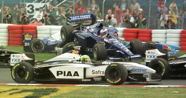 1998 Canadian Grand Prix.Montreal, Quebec, Canada. 5-7 June 1998.Jarno Trulli (Prost AP01-Peugeot) flies through the air before landing on top of Alexander Wurz (Benetton B198 Playlife) at the first corner.World Copyright - Steve Etherington/LAT Photographic