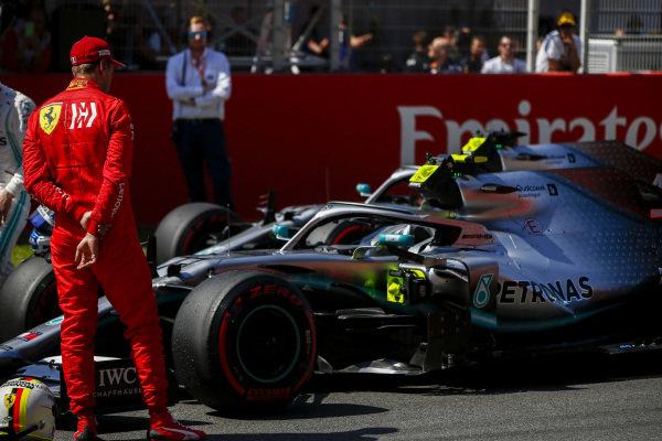 Sebastian Vettel, Ferrari looks at the car of Pole Sitter Valtteri Bottas, Mercedes AMG W10 in Parc Ferme