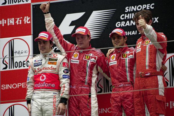 Podium group photo: Fernando Alonso, 2nd position, winner Kimi Räikkonen, Felipe Massa, 3rd position and Massa's race engineer Rob Smedley.