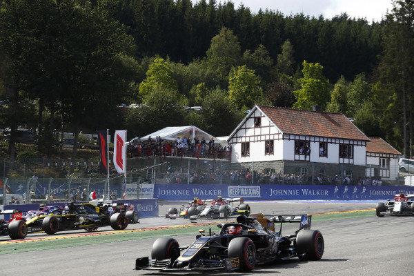 Kevin Magnussen, Haas VF-19, leads Daniel Ricciardo, Renault R.S.19, who has been hit, Antonio Giovinazzi, Alfa Romeo Racing C38, Kimi Raikkonen, Alfa Romeo Racing C38 and Alexander Albon, Red Bull RB15