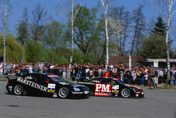 2002 DTM Press DayEuropa park, Germany. 4th April 2002.Marcel Fassler (HWA Mercedes 2002) and Timo Scheider (Holzer Opel 2002), action.World Copyright: Peter Spinney/LAT Photographic
