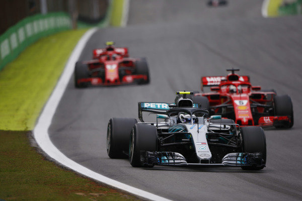 Valtteri Bottas, Mercedes AMG F1 W09, leads Sebastian Vettel, Ferrari SF71H, and Kimi Raikkonen, Ferrari SF71H.