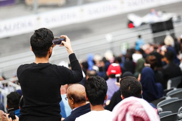 Fan films the race