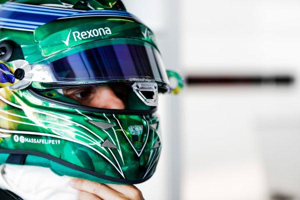 Yas Marina Circuit, Abu Dhabi, United Arab Emirates. Friday 24 November 2017. Felipe Massa, Williams Martini Racing, puts on a special livery helmet. World Copyright: Glenn Dunbar/LAT Images  ref: Digital Image _X4I5510
