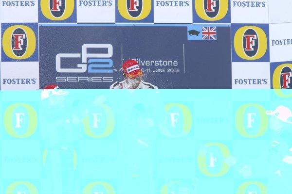 2006 GP2 Series Round 6. Silverstone, England. 11th June 2006. Sunday race. Lewis Hamilton (GBR, ART Grand Prix) 1st, Felix Porteiro (ESP, Campos Racing) 2nd, Adam Carroll (GBR, Racing Engineering) 3rd spray champagne. Podium.World Copyright: Jakob Ebrey/GP2 Series Media Service. Ref: Digital Image Only.YY8P4334 jpg