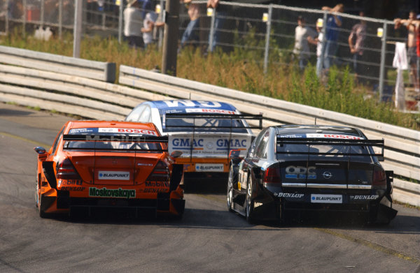 2005 DTM Championship Norisring, Germany. 16th - 17th July 2005 Marcel Fassler (Opel Vecrta GTS V8) leads Alexandros Margaritis (Mucke Motorsport AMG-Mercedes C-Klasse) and Laurent Aiello (Opel Vectra GTS V8). Action World Copyright: Andre Irlmeier / LAT Photographic ref: Digital Image Only