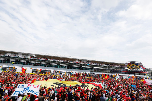 Autodromo Nazionale di Monza, Monza, Italy. 8th September 2013. A sea of Ferrari fans gather around the podium. World Copyright: Charles Coates/LAT Photographic. ref: Digital Image _N7T5821