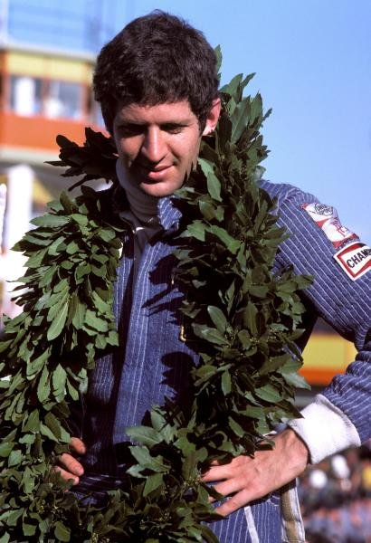 Jody Scheckter (RSA) celebrates a historic victory in the opening race of the season, as the Wolf team he drove for became the first and only constructor to win on their GP debut.
