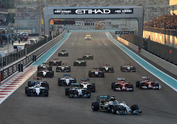 Lewis Hamilton (GBR) Mercedes AMG F1 W05 leads at the start of the race. Formula One World Championship, Rd19, Abu Dhabi Grand Prix, Race, Yas Marina Circuit, Abu Dhabi, UAE, Sunday 23 November 2014.  BEST IMAGE
