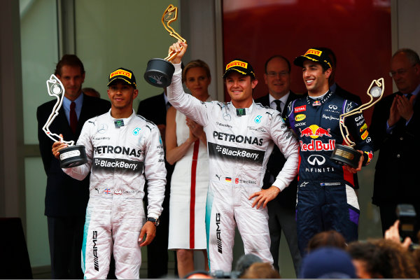 Monte Carlo, Monaco. Sunday 25 May 2014. Lewis Hamilton, Mercedes AMG, 2nd Position, Nico Rosberg, Mercedes AMG, 1st Position, and Daniel Ricciardo, Red Bull Racing, 3rd Position, on the podium. World Copyright: Andy Hone/LAT Photographic. ref: Digital Image _ONZ7680