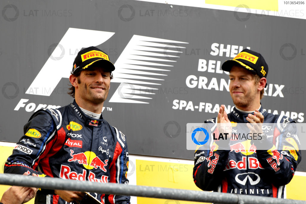 Spa-Francorchamps, Spa, Belgium28th August 2011.Sebastian Vettel, Red Bull Racing RB7 Renault, 1st position, and Mark Webber, Red Bull Racing RB7 Renault, 2nd position, on the podium. Portrait. Podium. World Copyright: Andy Hone/LAT Photographicref: Digital Image CI0C2510