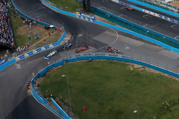 2014 FIA Formula E Championship. Punta del Este ePrix, Uruguay. Antonio Garcia (ESP)/China Racing - Spark-Renault SRT_01E and Karun Chandhok (IND)/Mahindra Racing - Spark-Renault SRT_01E spin. Photo: Zak Mauger/LAT/FE ref: Digital Image _L0U1821
