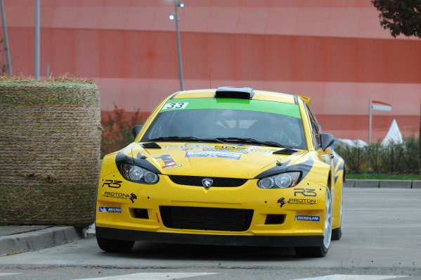 PG Andersson (SWE) and Emil Axelsson (SWE), Proton Satria Neo S2000 on the shakedown stage. FIA World Rally Championship, Rd11, Rallye De France, Strasbourg, Alsace, France, Shakedown, Thursday 4 October 2012.