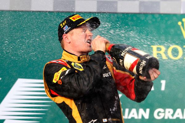 Albert Park, Melbourne, Australia Sunday 17th March 2013 Kimi Raikkonen, Lotus F1, 1st position, tastes victory on the podium. World Copyright: Glenn Dunbar/  ref: Digital Image _89P4967