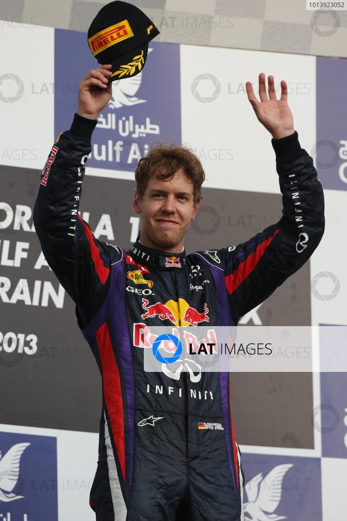 Bahrain International Circuit, Sakhir, Bahrain Sunday 21st April 2013 Sebastian Vettel, Red Bull Racing, 1st position, celebrates on the podium. World Copyright: Andy Hone/LAT Photographic ref: Digital Image HONZ2976