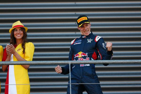 2014 GP3 Series Round 6.  Spa-Francorchamps, Spa, Belgium. Sunday 24 August 2014.  Alex Lynn (GBR, Carlin) celebrates his win on the podium. Photo: Sam Bloxham/GP3 Series Media Service. ref: Digital Image _SBL7059