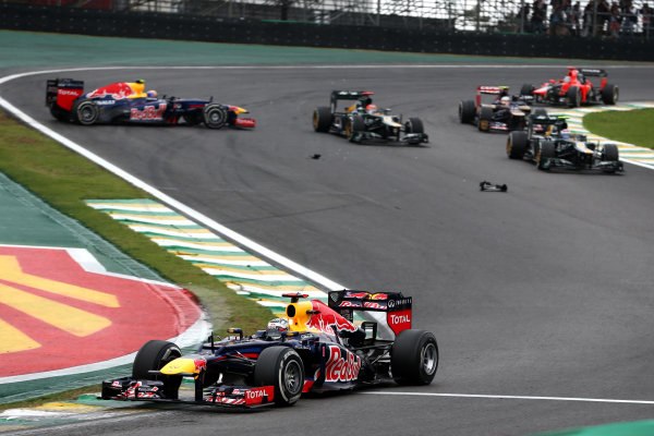 Interlagos, Sao Paulo, Brazil. Sunday 25th November 2012. Sebastian Vettel, Red Bull RB8 Renault, leads Vitaly Petrov, Caterham CT01 Renault, Heikki Kovalainen, Caterham CT01 Renault, Jean-Eric Vergne, Toro Rosso STR7 Ferrari, and Timo Glock, Marussia MR01 Cosworth, as they pass Mark Webber, Red Bull RB8 Renault, who suffers a spin. World Copyright:Andy Hone/LAT Photographic ref: Digital Image HONY3193