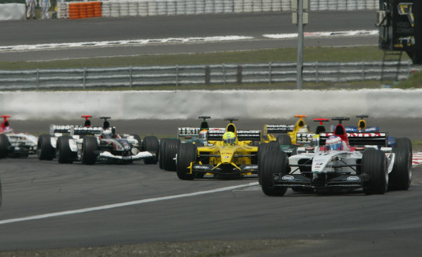 2003 European Grand Prix - Sunday Race,Nurburgring, Germany. 29th June 2003 Jenson Button, BAR Honda 005, leads the mid field charge.World Copyright: Steve Etherington/LAT Photographic ref: Digital Image Only